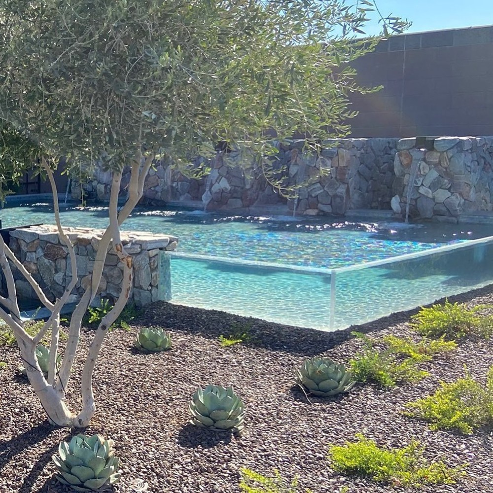 glass pool with stone fountains